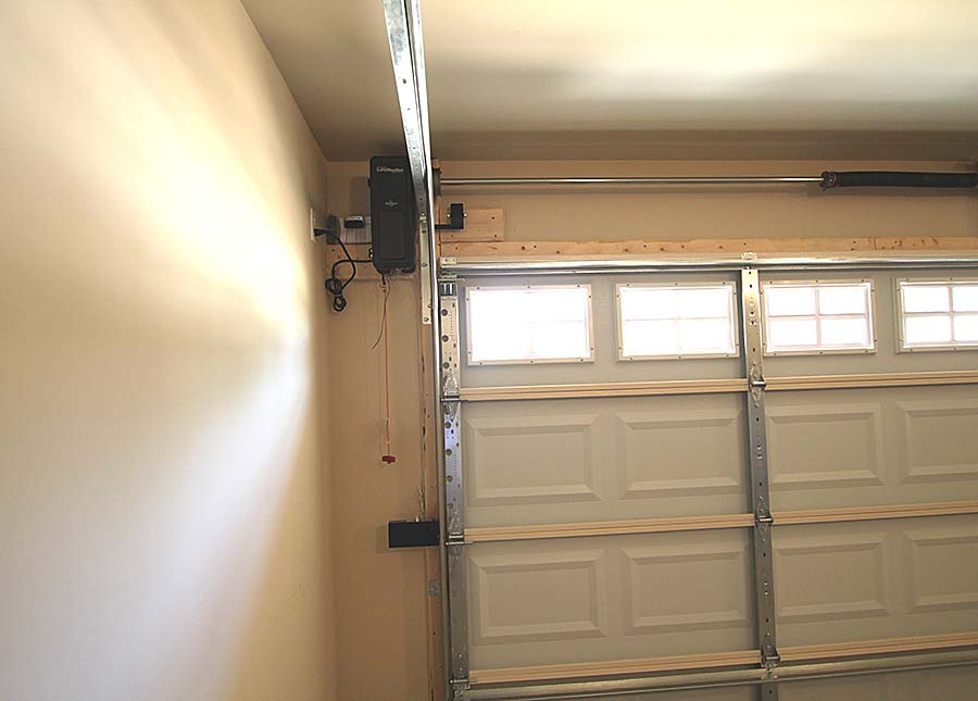 Jack Post garage door openers are installed beside the garage door - not having the garage door opener on the ceiling means there is more ceiling space for vehicle doors to open and close.