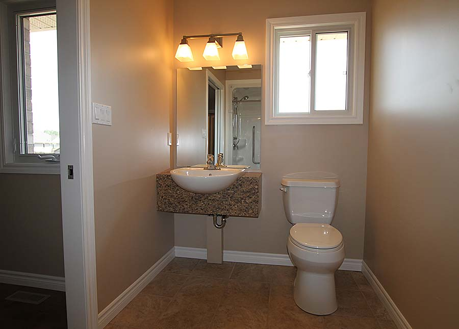 An accessible vanity and toilet ease maneuvering in the bathroom (in this case the client did not want extra space beside the toilet).