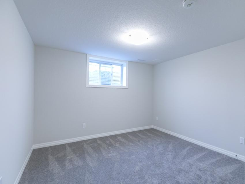 Basement Bedroom *exact features & finishes may vary slightly from photo
