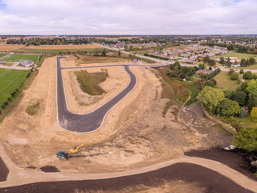 Roads are in at Glendale West - construction of houses is now starting!  This photo is taken from the south end of the site looking north.  Photo taken October 6, 2015.